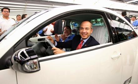 Mexican President Felipe Calderon sits in a VW Beetle in Puebla